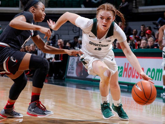 Michigan State's Taryn McCutcheon, right, drives against
