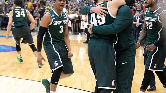 Drew Valentine and Denzel Valentine embrace after Michigan State toppled Louisville on Sunday to earn a trip to the Final Four.