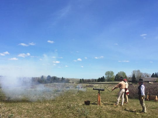 A cannon such as the Lewis and Clark expedition would have used is fired at the Lewis & Clark Interpretive Center on Sunday afternoon.