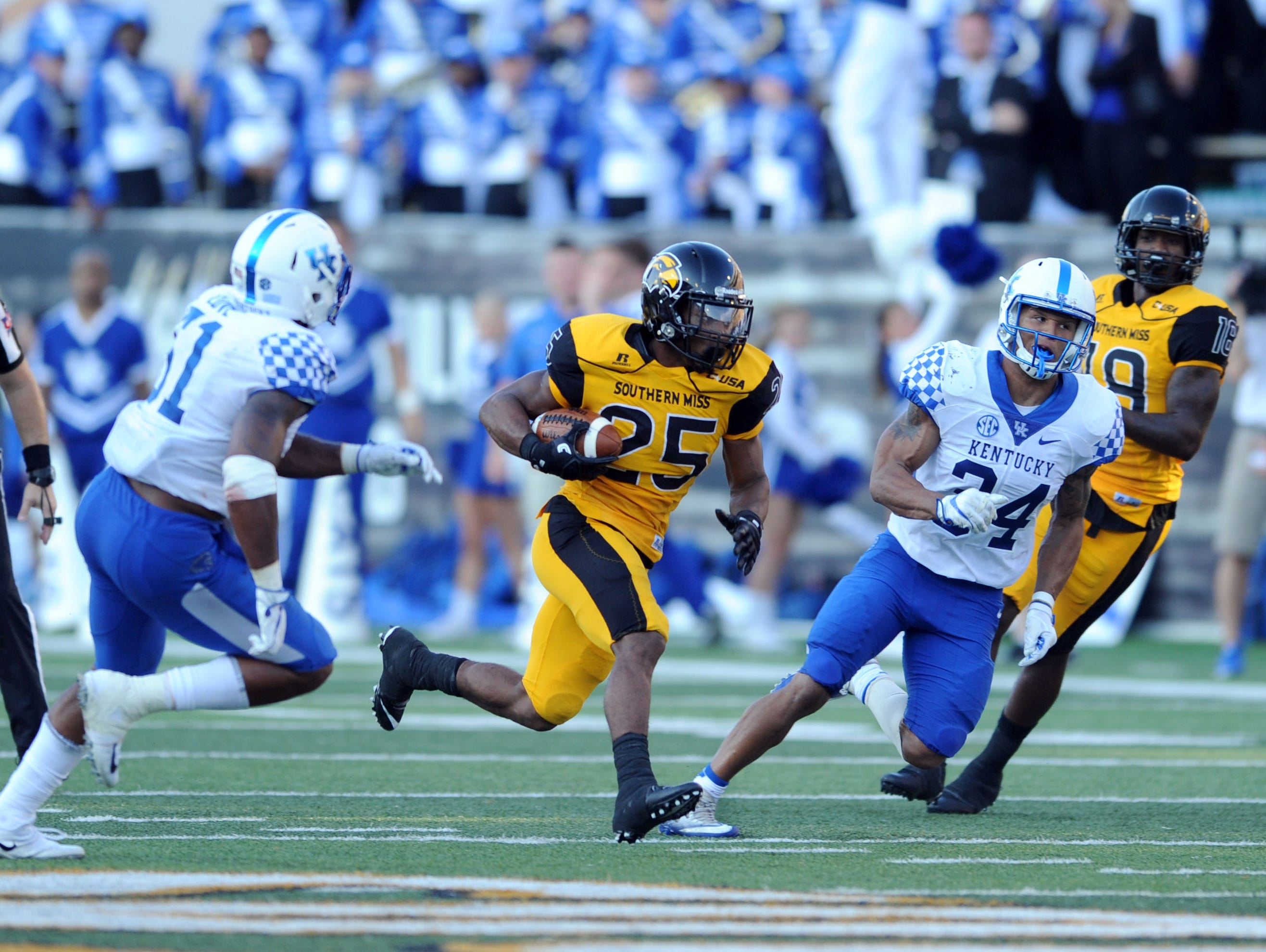 Southern Miss running back Ito Smith carries the ball in a game against Kentucky at M.M. Roberts Stadium on Saturday.