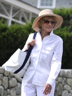 Jean Kennedy Smith walks down Hawthorne Avenue in Hyannis to the Shriver home shortly after her sister Eunice Kennedy Shriver died. Smith died Wednesday at age 92.