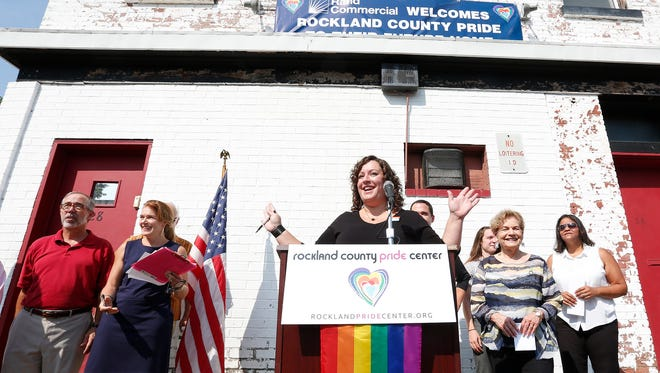 Executive Director of the Rockland County Pride Center Brooke Malloy announces the purchase of a building during a press conference in Nyack on Saturday, September 10, 2016.