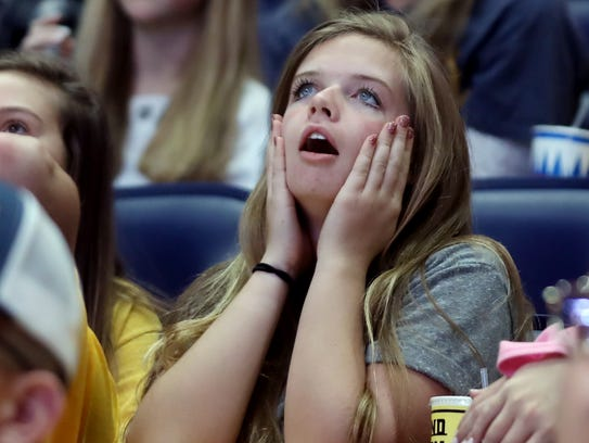 Lauren Elliott reacts as the Jets tie the game during