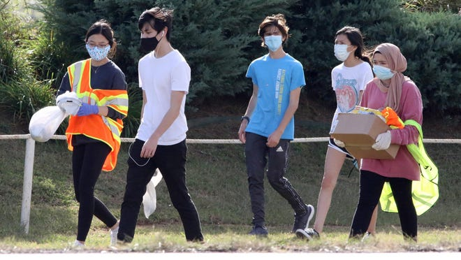 Members of Southside High School Earth Club, Trista Truong, from left, Tobey Yu, Braeden Wear, Andrea Ortega and Nabila Siddiqui pick up trash, Friday, Oct. 9, along S. Zero St. at Ben Geren Park.