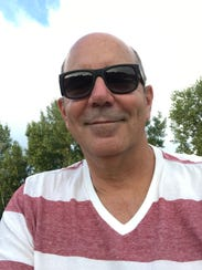 Doug Hoffman, 55, is a Republican and retired police