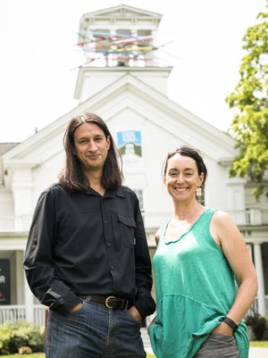 """Outgoing executive director Nathan Suter and incoming executive director Rachel Moore in front of Rob Hitzig's outdoor work """"Pick 'Em Up"""" from the """"Exposed"""" exhibit at the Helen Day Art Center in Stowe, Vermont on Monday, July 25, 2016."""