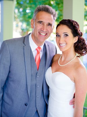Erica Siciliano and her father show their Hybridge smiles on her wedding day.