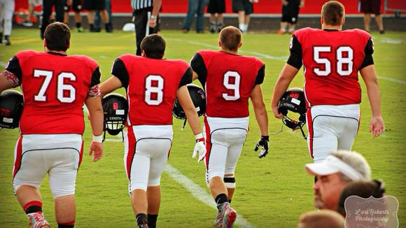 Andrews captains Willie Parker (76), Grayson Parker (8), Dillan Ward (9) and Tyler Holloway (58) take the field prior to Friday's game against Tellico Plains (Tenn.).