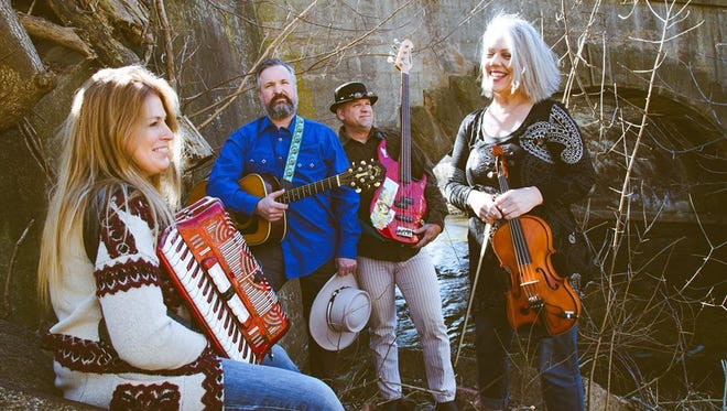 "Join Tale Spin at the Oconomowoc Arts Center. Band members are Ken Schmidt on guitar, vocals and harmonica, Kim McKisick Monroe on violin, Amy Schmidt on accordion and mykul j steinke (""mykulanjelo"") on bass and vocals."