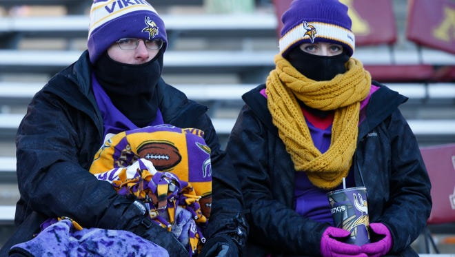 Minnesota Vikings fans sit ithe stands after an NFL wild-card football game against the Seattle Seahawks, Sunday, Jan. 10, in Minneapolis.