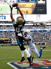 Dec 3, 2017; Jacksonville, FL, USA; Indianapolis Colts cornerback Nate Hairston (27) can't stop Jacksonville Jaguars wide receiver Keelan Cole (84) who grabs a pass for a touchdown during the second quarter at EverBank Field. Mandatory Credit: Reinhold Matay-USA TODAY Sports