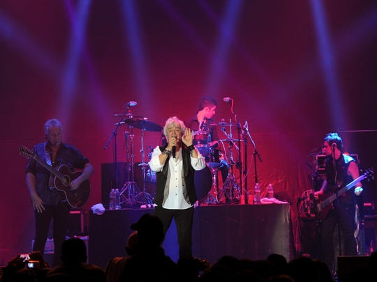 """Russell Hitchcock of Australian rock band """"Air Supply"""" performs during a concert in Yangon on August 15, 2013. AFP PHOTO/ Soe Than WIN (Photo credit should read Soe Than WIN/AFP/Getty Images)"""