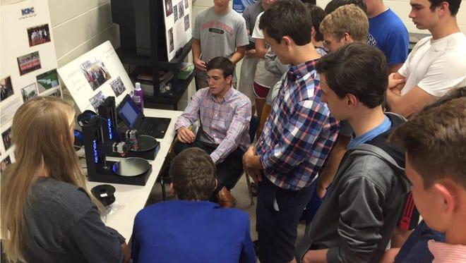 University of Cincinnati student Nick Jones, a Polar 3D intern, teaches an entrepreneurship class at Mariemont High School with Polar 3D printers.