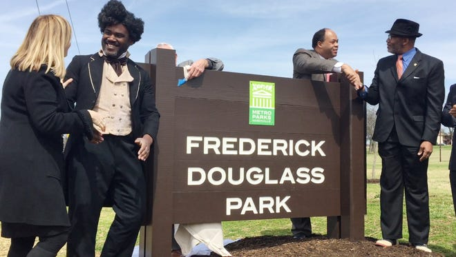 Mayor Megan Barry, left, shakes the hand of Frederick Douglass impersonator Bakari King at the restoration ceremony for Frederick Douglass Park on March 22, 2017. Douglass' great-great-grandson Kevin Douglass Greene, far right, shakes the hand of local attorney David Ewing, who helped with the research to get the park's name restored to honor the abolitionist.