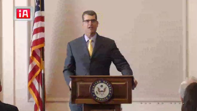 Michigan football coach Jim Harbaugh speaking at the Legal Services Corp. hearing June 14, 2017, in Washington, D.C.
