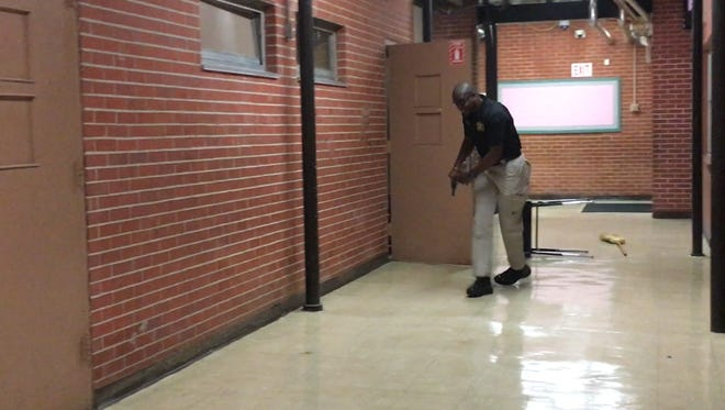 Hattiesburg police training director Lt. Chris Johnson plays the role of an active shooter during a training exercise Tuesday.