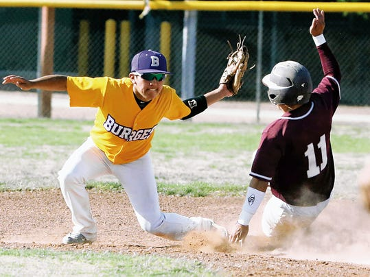 Rudy Gutierrez—El Paso Times Burges infielder Alex Quintana, left, catches the throw to second as Ysleta's Victor Gonzalez, 11, slides in Friday at  Burges. The umpire called Gonzalez safe.