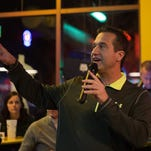 CSU volleyball coach Tom Hilbert addresses the crowd at Fuzzy's Taco Shop before they watch the NCAA Volleyball Selection Show in Fort Collins on Sunday.
