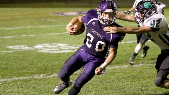 Ben Robinson (20) and Mitchell are home for Friday's third round of the NCHSAA 1-A football playoffs.