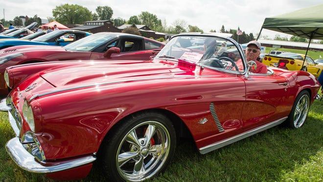 Bruce Miller of Tekonsha sits in his 1962 Corvette at Cornwell's Turkeyville for Sunday's show.