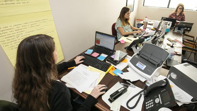 Contact Tracers Kaitlin Brittain, left, Rachael Shaw, center and Megan Jones, right, all grad students from the University of Florida, work on tracking down positive COVID-19 patients on the phone at the Florida Department of Health in Marion County on July 14.