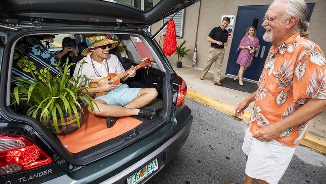 "Vanguard High School senior Andres Trias plays ""Margaritaville"" on his ukulele, surprising teacher Todd Carstenn on Friday May 29."