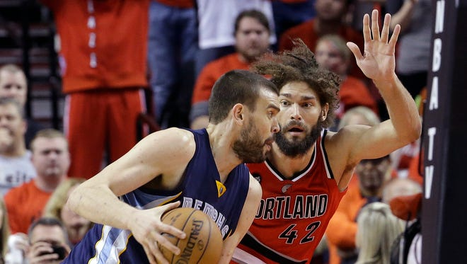 Memphis Grizzlies center Marc Gasol, from Spain, left, drives on Portland Trail Blazers center Robin Lopez during the second half of Game 3 of a first-round NBA basketball playoff series in Portland, Ore., Saturday, April 25, 2015.  Portland, Ore., Saturday, April 25, 2015.  Gasol led the Grizzlies in scoring with 25 points as they beat the Trail Blazers 115-109.