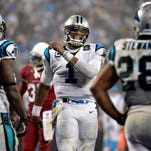 Carolina Panthers quarterback Cam Newton (1) reacts during the fourth quarter of the team's victory over the Arizona Cardinals.