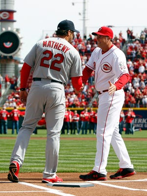 Reds manager Bryan Price and Cardinals manager Mike Matheny shake hands at the plate prior to their Opening Day game at Great American Ball Park.