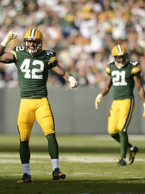 Green Bay Packers safety Morgan Burnett (42) reacts after breaking up a play in the second quarter during Sunday's game against the New York Jets at Lambeau Field.