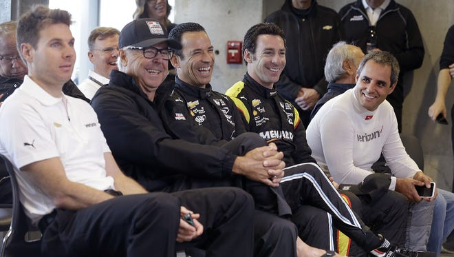 The Penske drivers Will Power,left, team consultant Rick Mears, driver Helio Castroneves, Simon Pagenaud and Juan Palo Montoya laugh as they ask team owner Roger Penske about driving the pace car for the 100th running of the Indianapolis 500 Friday, May 13, 2016, morning at the Indianapolis Motor Speedway.