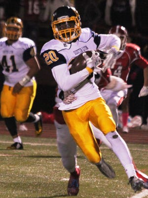 South Lyon's Danique Lewis goes for yards after the catch against John Glenn.