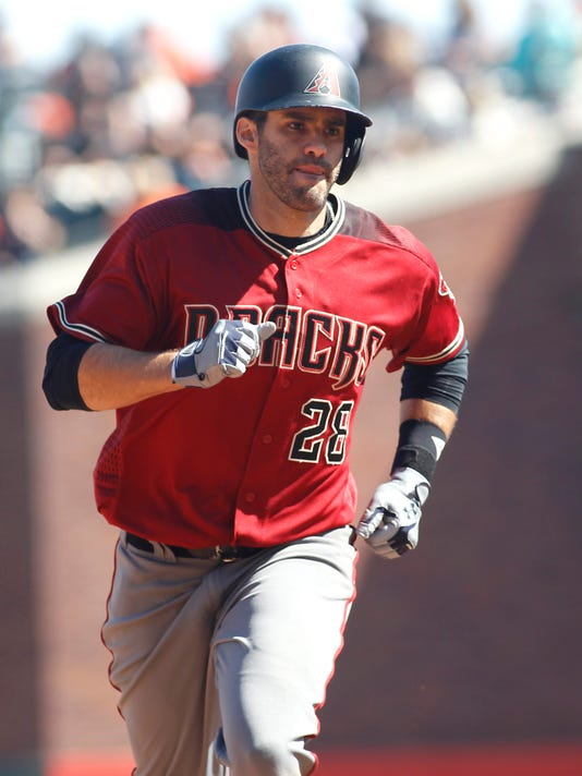Arizona Diamondbacks' J.D. Martinez rounds the bases after hitting a two-run home run against the San Francisco Giants during the sixth inning of a baseball game, Sunday, Sept. 17, 2017, in San Francisco. Paul Goldschmidt scored on the home run. (AP Photo/George Nikitin)