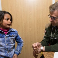 Brookfield pediatric neurologist Tarif Backdash examines 8-year-old Sandy Al Mekdad who has a congenital defect known as tethered spinal cord.