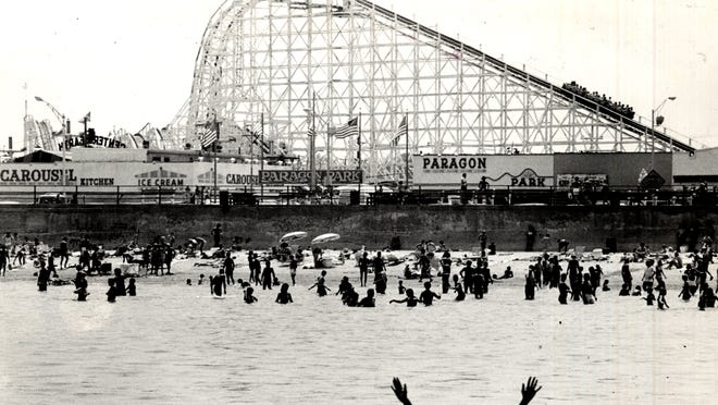 The roller coaster at Paragon Park dominates the Hull skyline as viewed from the waters off Nantasket Beach in this 1980 file photo.