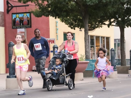 Participants in the Electric 5K Road Race, hosted by