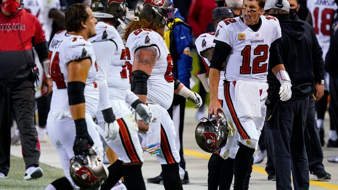 Tampa Bay Buccaneers quarterback Tom Brady (12) yells at members of his offensive line as they walk off the field during the second half of an NFL football game against the Chicago Bears in Chicago, Thursday, Oct. 8, 2020.