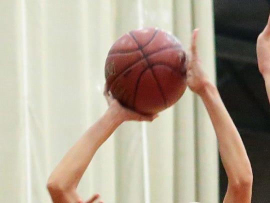 Girls' basketball action.