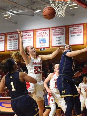Marist College's Rebekah Hand goes for a loose ball against Navy at McCann Arena in Poughkeepsie on Friday.