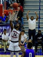 USI's Emmanuel Little (14) makes a layup as he plays against the Brescia Bearcats at USI's Physical Activities Center in Evansville, Ind., Tuesday, Nov. 14, 2017. The Screaming Eagles defeated the Bearcats, 93-67.