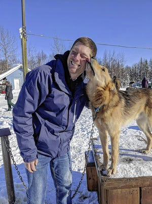 Ridgewood Elementary School third-grade teacher Jim Deprez gets a kiss from an Iditarod sled dog earlier this year in Alaska. Deprez, who uses the dogsled race to teach various subjects, has been named the 2021 Iditarod Teacher on the Trail and plans to travel with the support team during next year's race.