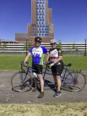 """Upper Arlington residents Gregg Goldenbagen and Mary Beth Cowardin want to raise $2,000 through 20 rides on a tandem bicycle. """"You really have to ride in sync to ride tandem, and we're all in this together,"""" Cowardin said."""