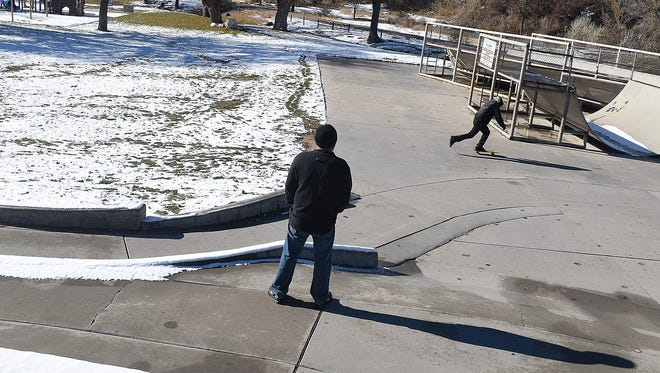 Jeconiah Lee gets in some skateboarding after the sun made an appearance on Tuesday at Brookside Park in Farmington.