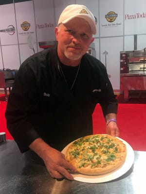 Bob Yacone, owner of Forghedaboudit Authentic New York Italian Cuisine, put together a shrimp, avocado and smoked bacon pizza for the non-traditional pizza division.