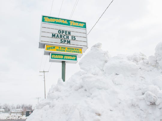 A pile of snow sits in front of the Tropical Treat