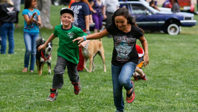 Nyonica Ponder is chased by Jordan Seagrave during Fiesta Days on June 6, 2015, at Minium Park in Aztec