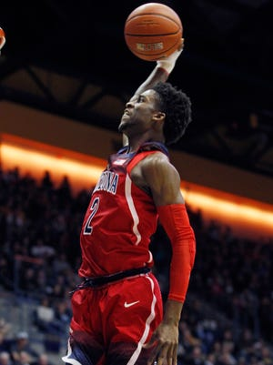 Arizona's Kobi Simmons dunks against California during the first half of an NCAA college basketball game, Friday, Dec. 30, 2016, in Berkeley, Calif.