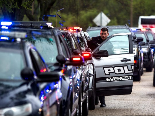 Everest Metro Police Department vehicles prepare for the procession to the Wisconsin State Capitol building before the Wisconsin Law Enforcement Memorial Ceremony in Olin Park in Madison, Wis., Friday, May 11, 2018.