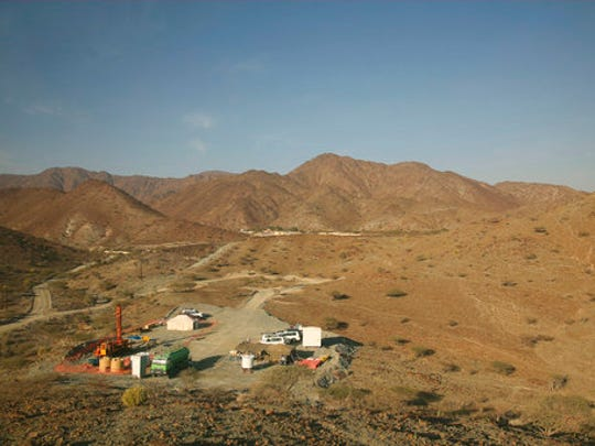 This March 1, 2017 photo, shows a drilling site of the Oman Drilling Project in the al-Hajjar mountains of Oman. Deep in the jagged red mountains, geologists are drilling in search of the holy grail of reversing climate change: an efficient and cheap way to remove carbon dioxide from the air and oceans. They are coring samples from one of the world's only exposed sections of the Earth's mantle to uncover how a spontaneous natural process millions of years ago transformed CO2 into limestone and marble.