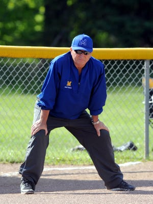 Maysville coach Greg Vaughn watches his team from the third base coaches box during a sectional tournament game against Rayland Buckeye Local in a 2016 Division II district final at Cambridge City Park. Vaughn retired after 33 years in coaching — 17 in softball.